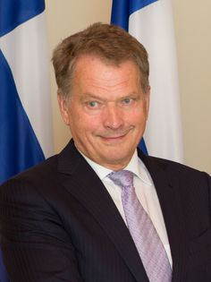 Government: This picture shows the president of Finland. His name is Sauli Niinistö. He was elected in 2012. The president is elected by the people in Finland, and they  have a six year term. The president is not allowed to serve more than two terms in a row. The president can veto any bills and issue orders. He handles all of the foreign relations. The president also is the head of the armed forces.