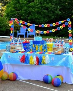 13 bold pool dessert table decorated with life savers and garlands - Shelterness