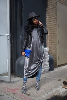 We haven't retired the classic slip dress over jeans just yet. To give the look a true street style touch, ...
