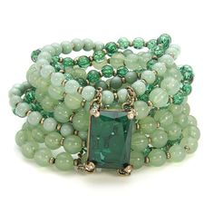 Seafoam green bracelet with beads and dark green gem.                                                                                                                                                     More