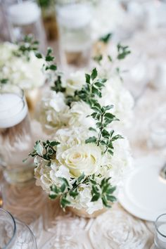 Classic + romantic wedding floral centerpiece idea - ivory roses, white hydrangeas and greenery {Rebecca Ames Photography}