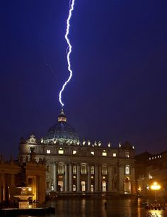 Lightning strikes St. Peter's basilica during a storm in the Vatican City on Feb. 11, 2013, the same day Pope Benedict XVI announced his resignation.