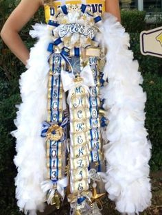 Don't buy a tacky mum....these mums are the most beautiful mums in Texas (or any other state that does mums for homecoming - it's a southern thing, the rest of you won't understand). Hands down, you won't find a better mum in construction, quality or craftsmanship than these. Check out Angel's Nest mums on either Facebook, Etsy or Pinterest. Don't waste your money on tacky mums!