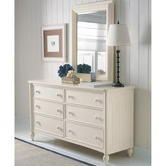Southport Dresser in a Sail Cloth finish at D Noblin Furniture...The welcome home feel of a cottage can be found in this Southport dresser. Wainscoting selected cases and panel bed, beehive turning on the wood pulls, and Sail Cloth white painted finish provide this relaxed, casual appeal.