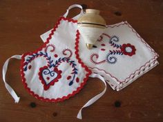 this Portuguese heart inspired by traditional Viana embroidery where the red and blue are the most usual colors and hearts a very common motif