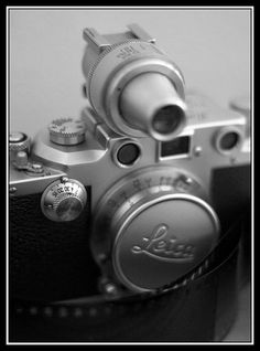 Leica IIIc and a Vidom viewfinder.