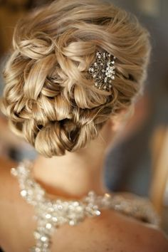 Another 25 Bridal Hairstyles & Wedding Updos | Confetti Daydreams - Bridal hairstyle with hair knotted from the bottom all the way up with the front bangs swept back and accessorised with a beautiful hair brooch ♥ #Wedding #Bridal #Hair #Updo #Hairstyle♥  ♥  ♥ LIKE US ON FB: https://www.facebook.com/NewsFavors  ♥  ♥  ♥