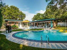 Sneak peek: Goes on sale Thursday Which photo to to lead with? The front with the pink Cadillac? Or the back, with Bob's Big Boy guarding the pool? Now those are decisions I don't get to make every day! Thanks to our good friend Ed Murchison, midcentury modern house realtor extraordinaire, we are getting a …
