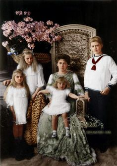 Crown Princess (later Queen) Marie of Romania and her 4 eldest children. From left, Princess Marie (later Queen of Yugoslavia), Princess Elisabeth (later Queen of Greece), Prince Nicholas, and Prince Carol (later King Carol II).