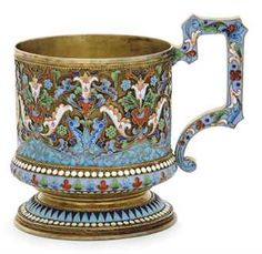 A RUSSIAN SILVER-GILT AND CLOISONNE ENAMEL TEA GLASS HOLDER  MARK OF IVAN SALTYKOV, MOSCOW, CIRCA 1890http://www.christies.com/