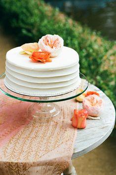 perfectly simple wedding cake, photo by Christianne Taylor http://ruffledblog.com/sophisticated-calamigos-ranch-wedding #cakes #weddingcake