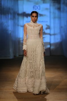Sheer ivory anarkali with delicate silk appliqué, resham embroidery and corded yoke