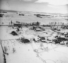 Battle Of The Bulge - Aerial view over Ardennes showing village battered from Battle of the Bulge fighting. 1945.