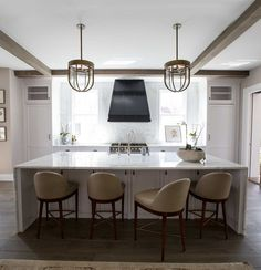 I like island ,chairs and maybe ceiling.Move stove to exterior wall and flank with windows. the chairs are great function and comfort