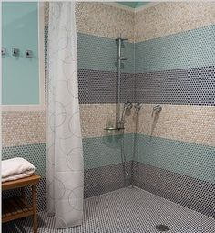 Minimal upkeep, no glass doors to clean! Sign me up for a walk in doorless shower in pewter and white!