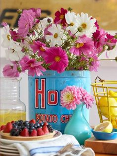 A brightly colored can paired with a vibrantly colored bouquet means lots of spring cheer! More spring centerpiece ideas: http://www.midwestliving.com/homes/seasonal-decorating/50-bright-and-easy-spring-decorating-ideas/?page=37