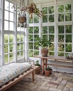 Decorate your orangery with a daybed and add floral fabrics and potted plans to create a cozy zone. Old windows and hanging plants from ceiling. Outdoor Rooms, Outdoor Living, Outdoor Decor, Small Sunroom, Inside Design, House Windows, Glass House, Future House, New Homes