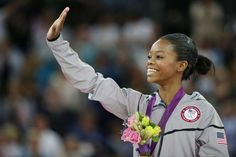 US gymnast Gabrielle Douglas celebrates on the podium after winning the artistic gymnastics women's ... - Thomas Coex/AFP/GettyImages