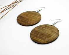Disk shape earrings made of greek walnut wood. High-class timber with compelling colouration, an exquisite pair of earrings with a character that only nature can provide. Hang from dull plated silver hook wire with bead and loop. Handmade Chandelier, Modern Chandelier, Wood Earrings, Chandelier Earrings, Circle Shape, High Class, Wooden Jewelry, Walnut Wood, Wood Grain