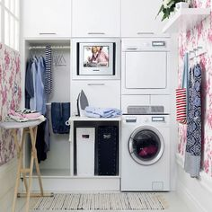 stack washer/dryer- good use of vertical space-- plus I love a hot pink laundry room!