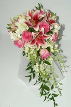 Cascade Bouquet - Starfighter lilies, Dendrobium Orchids, Pink Roses, Casablanca lilies and Snapdragons.