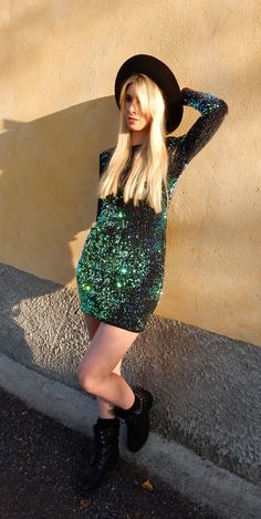 Sparkling green dress is a good way to grab someone's attention.