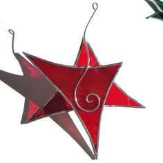 This festive little guy has lots of personality and looks as if it is jumping for joy!    It is made from clear red and swirled red glass.