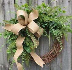 This beautiful burlap greenery wreath is the perfect simple accent for your door or interior. A wired burlap ribbon makes a simple bow. This wreaths fern and ivy have a light and airy feel where the grapevine base is visible in places.  Average Diameter: 22 (tip to tip) This wreath will be created on a grapevine wreath measuring approximately 18 Feel free to convo me if you would like to add a monogram to this wreath.  Indoor/ Sheltered Outdoor Safe *Try to avoid exposing this wreath to lots…