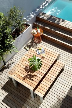 """STUA Deneb table teakwood, from sustainable forests. Floor and table withstand the harsh sun, in """"De Waterkant"""" project by Meier & Voster. (Furniture from Crema Design)"""
