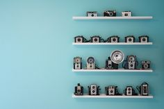 I want these cameras, and these shelves, and that turquoise wall... ! :)