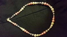 Check out this item in my Etsy shop https://www.etsy.com/listing/530620499/pearl-delight-necklace