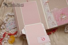 И второй парный альбомчик для малышки. Формат 18х25см, для фотографий 10х15см и 8х12см. 6 разворотов, есть кармашки для бирочек, карточки ...