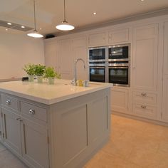 Grey kitchen island made by combining a number of base units, with panelled ends. Quartz worktop with undermounted sink. Kitchen Inspirations, Home Decor Kitchen, Kitchen Plans, Kitchen Interior, Freestanding Kitchen, Kitchen, Kitchen Dining Living, Grey Shaker Kitchen, Kitchen Diner Extension