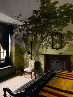 Crazy delightful room with the tree mural growing into the ceiling too.