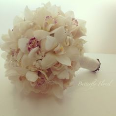 White Orchids and Roses bridal bouquet stems wrapped with lace