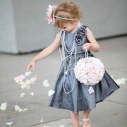 Flower girl basket,flower girl for vintage wedding, draped in pearls,wearing pink ballet slippers.