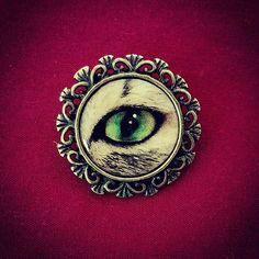 New #catseye #brooch on www.Shewalkssoftly.etsy.com!  #crafts #diy #handmade #jewelry #shewalkssoftly #shewalkssoftlycreations #etsy #crafters #craftersofinstagram #craftlover #craftsposure #handmadewithlove #modernvintage #curiosities #vintageinspired #oddities #antiqueinspired #catjewelry #cats #cateye #catseyes #pin