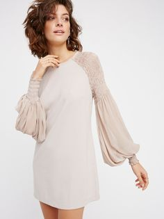 The Perfect Dress | Solid shift dress in an easy and stretchy fit features sheer statement long sleeves in a wide silhouette with smocked detailing on the shoulders. Exposed back zip closure.