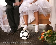 Soccer lovers wedding picture; would make a cute dance or prom photo