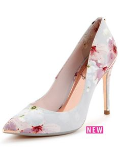 Ted Baker Kawaap Court Shoe - Oriental Blossom  Ted Baker deliver us another sophisticated style in the form of these Kawaap court shoes. Covered from heel to toe in oriental blossoms, they're a super pretty pair that are made oh-so chic with a pointed toe, skyscraper heel and metallic touches. Coordinate your look with a matching Ted Baker dress to turn heads at the most special occasions. Lining: Leather/TextileMaterial: LeatherSole: Other MaterialsUpper: Leather