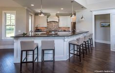 This kitchen provides plenty of causal sitting for meals. The Hartwell #1221