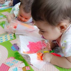 Who says 5 month olds can't create their first piece of art and the best part - it is non messy All you need is a large ziplock bag, a piece of thicker paper and some paints. Put various blobs of different colours seperately on the paper, seal it in the ziplock bag and have your little one have some fun scrunching the bag away to mix up the colours to create their little masterpiece, a great distraction for some tummy time too Take it out the plastic to dry, date it and proudly stick ...