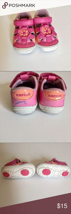 Surprize by Stride Rite Alexia infant/toddler shoe The rounded soles will help her balance while the secure closures will ensure she won't kick them off at the playground or grocery store. Whether she's cruising along the living room sofa or playing in the backyard, her feet will be comfy all day thanks to memory foam footbeds and breathable mesh toppers.                           These shoes have been worn, but still in great condition. Only imperfections are minor markings from wear and a…