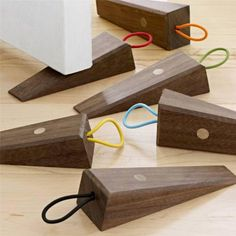 Turning an ordinary item into an elegant design is always a welcome addition to your home! Museum of Modern Art design, #MoMA Solid Walnut BEST Doorstop you will ever find!  Hanging Loop to keep on door knob when not in use. Who knew #doorstops could be so attractive!