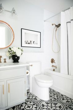 Marcus Design Before & After budget friendly main bath reno with @deltafaucetcan bronze fixtures and @minted artwork (photo by @traceyayton