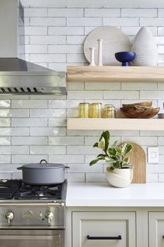 white kitchen with wood open shelving