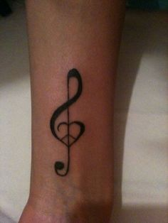 I fell for this design: Peace, Love & Music. Might be getting this for my fifth Tattoo (Safe to say I looove Tattoos)