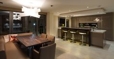 A dedicated seating area with bespoke seating creates a separate dining area within the kitchen