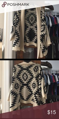 Luxe Cardigan Throw open face size M/L Luce Cardigan Open Face Throw size M/L. Worn but in great condition. Very few little fuzzies but can cleaned up with a razor. This goes with Everything, cream and black with a cool print. Luxe Essentials Apparel Sweaters Cardigans