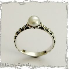 Thin floral silver engagement ring with a single pearl - Signs of time.. $44.00, via Etsy.